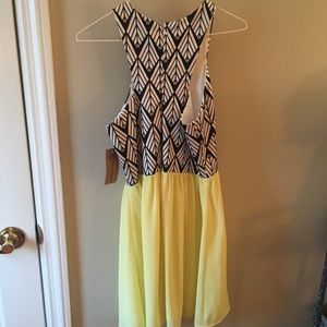 Dresses & Skirts - Black and white printed dress with yellow bottom